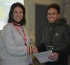 Julie Koopman, Volunteer Co-ordinator for the All Aboard charity, hands BTEC Business student Brayan Avalo Vasquez his winner's certificate