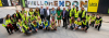 Students and staff from Barnet and Southgate College and L&Q unveil the new hoardings at Rookery Way