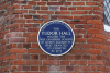 The plaque on the outside wall of Tudor Hall